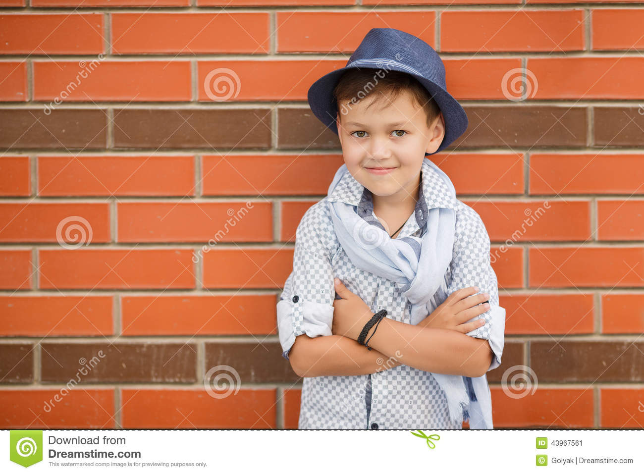Stylish Boy In Hat Posing On A Brick Wall Stock Image Image Of