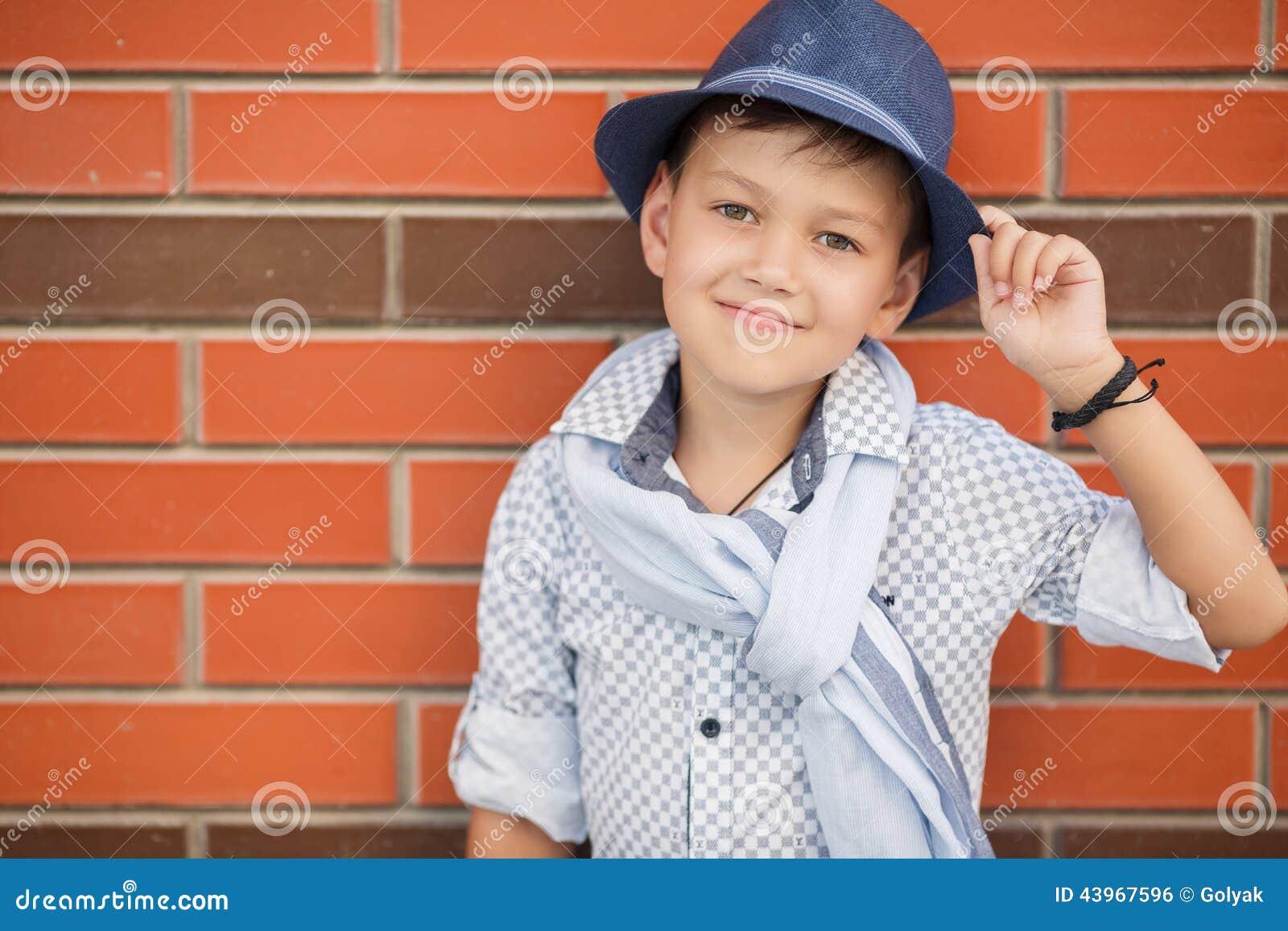 Baby stylish boy with hat catalog photo