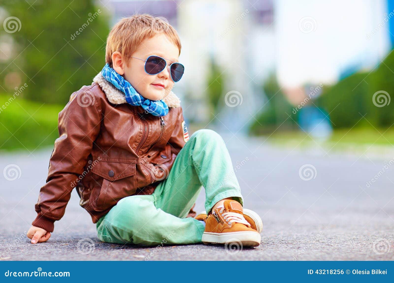 Stylish Boy In Leather Jacket Sitting On The Road Stock Photo