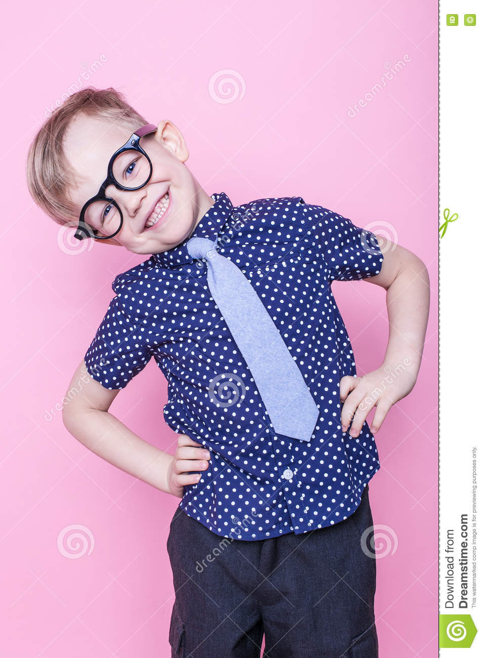 a8061b7813f Portrait of a little smiling boy in a funny glasses and tie. School.  Preschool. Fashion. Studio portrait over pink background