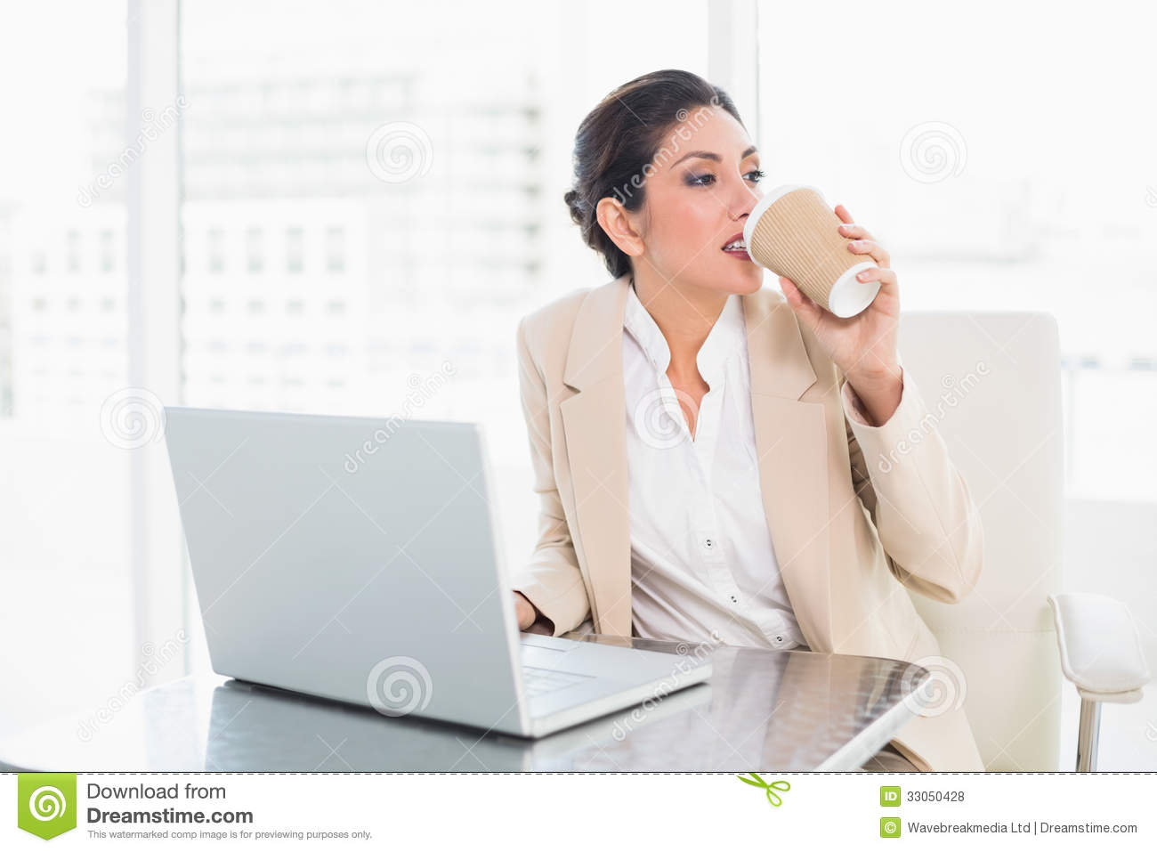 Stylish Businesswoman Drinking Coffee While Working On ...