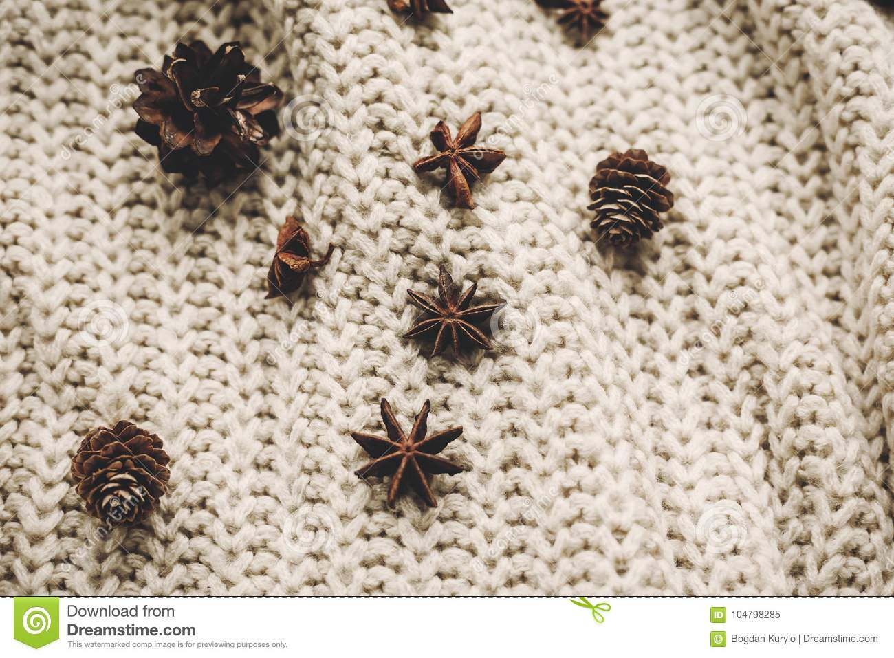 Stylish Christmas Flat Lay. Pine Cones Anise On Rustic Knitted S ...