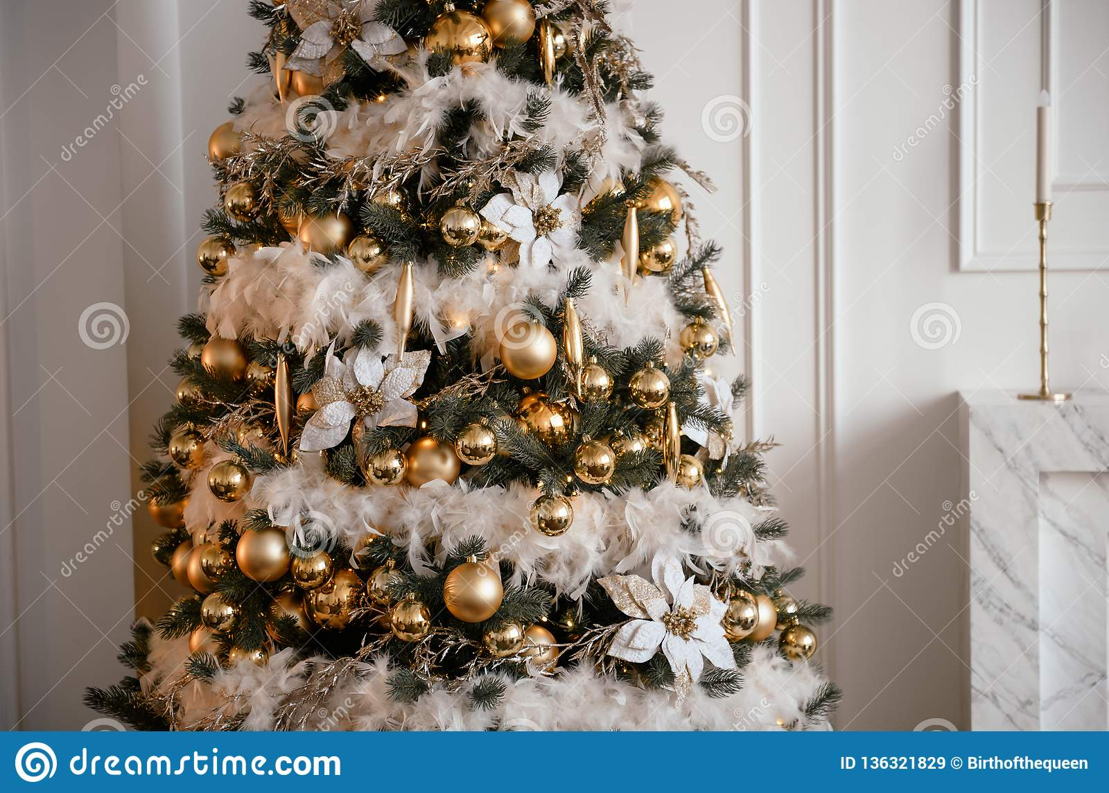 Stylish Christmas Living Room Decor In Gold And Silver Tones A Large Beautifully Decorated Christmas Tree Stands In The Room Next Stock Image Image Of Holiday Abstract 136321829