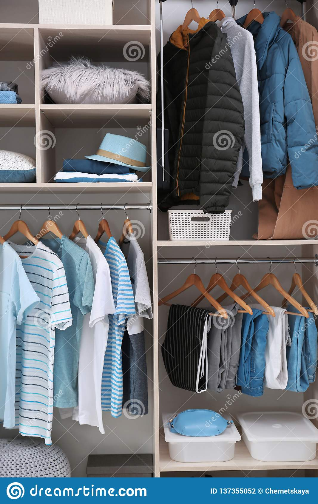 Stylish clothes and home stuff in large wardrobe