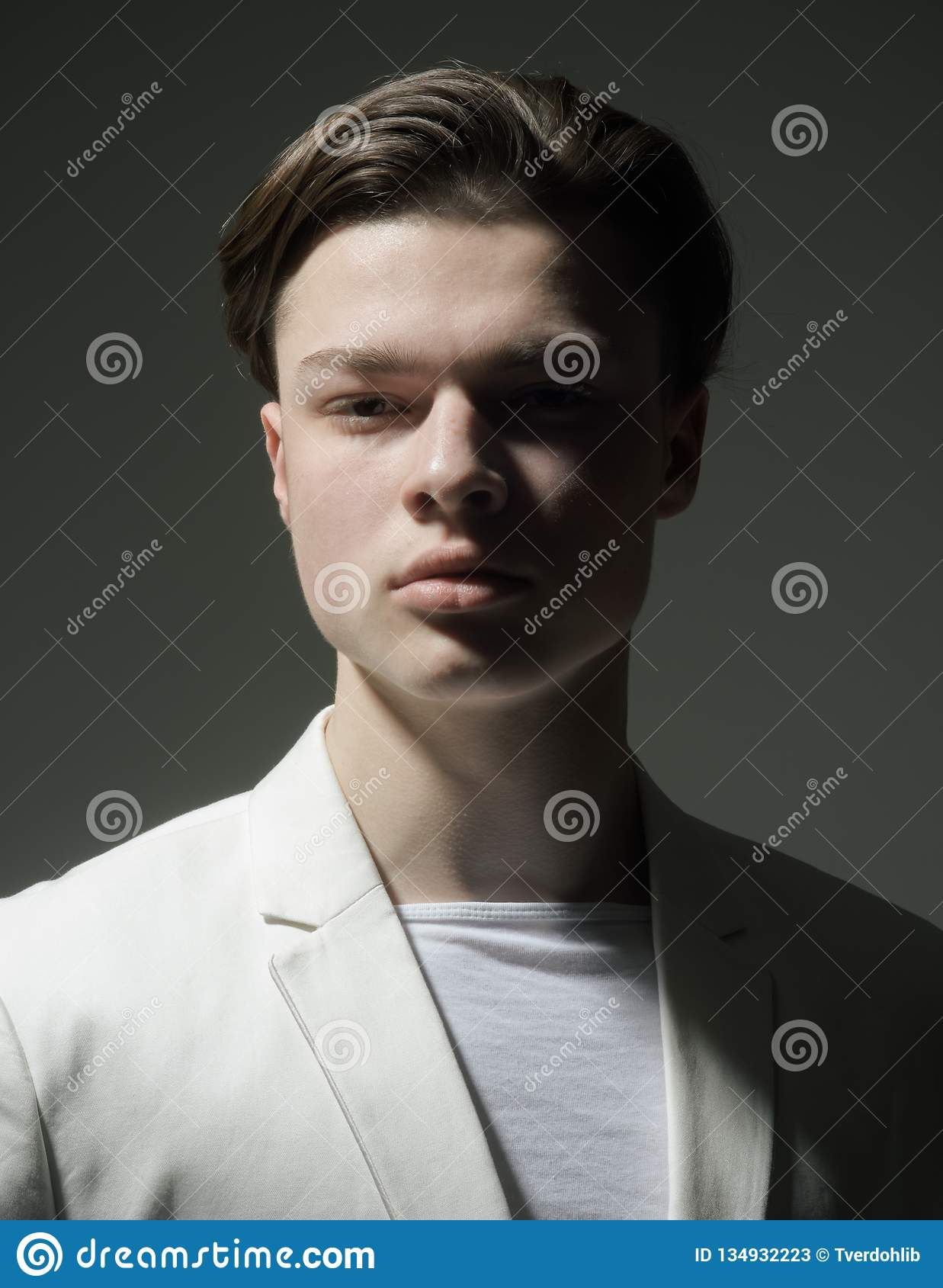 Stylish and confident. Fashion man with mystery look. Beauty and fashion. Man with trendy look. Hair style and skincare