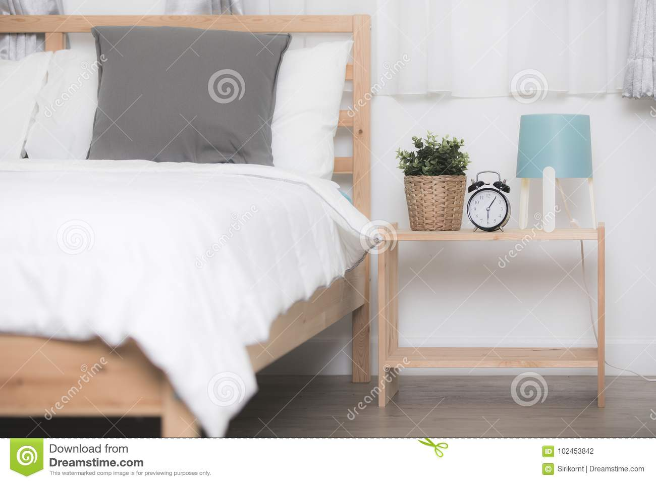 Stylish designed boy teenager`s bedroom with white walls and wood furniture and colorful decorations & Stylish Designed Boy Teenager`s Bedroom With White Walls Stock Photo ...