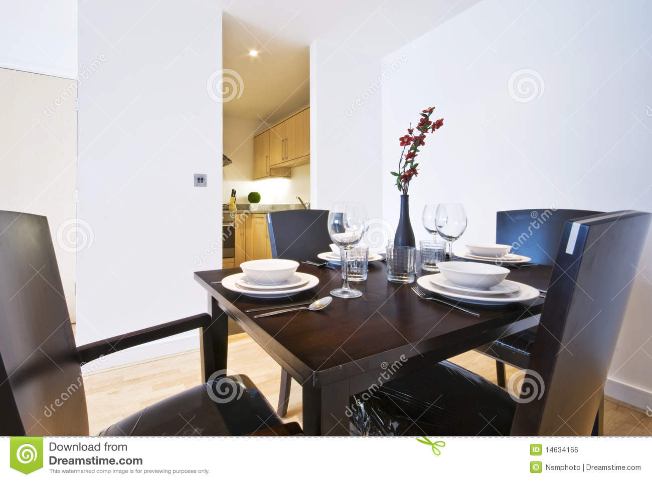 Stylish Dining Area With Set Up For Four Royalty Free