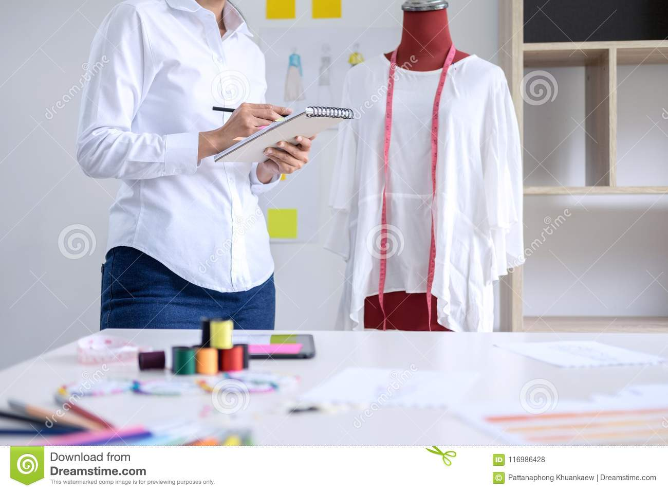 Stylish Fashion Designer Working With Measure Red Dummy As Sketches In Draft Book Of New Collection In Art Profession And Job Stock Photo Image Of Clipping Color 116986428