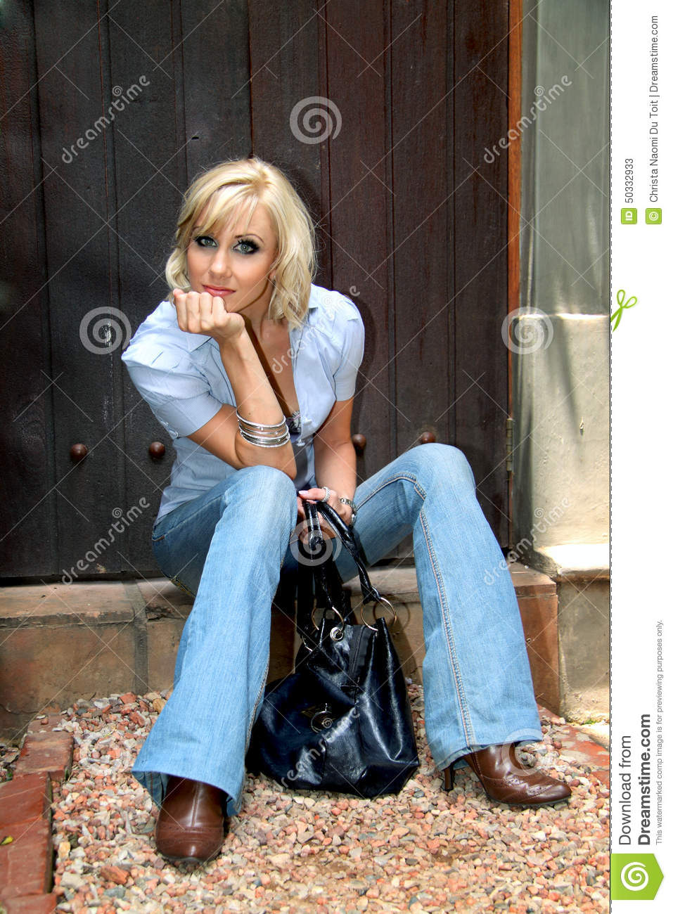 stylish fashion glamour model posing with jeans and boots