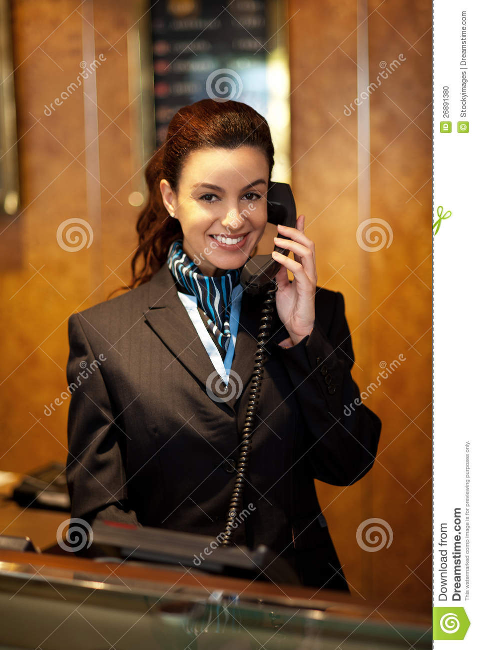 Stylish Female Attendant At Hotel Reception Stock Photo ...