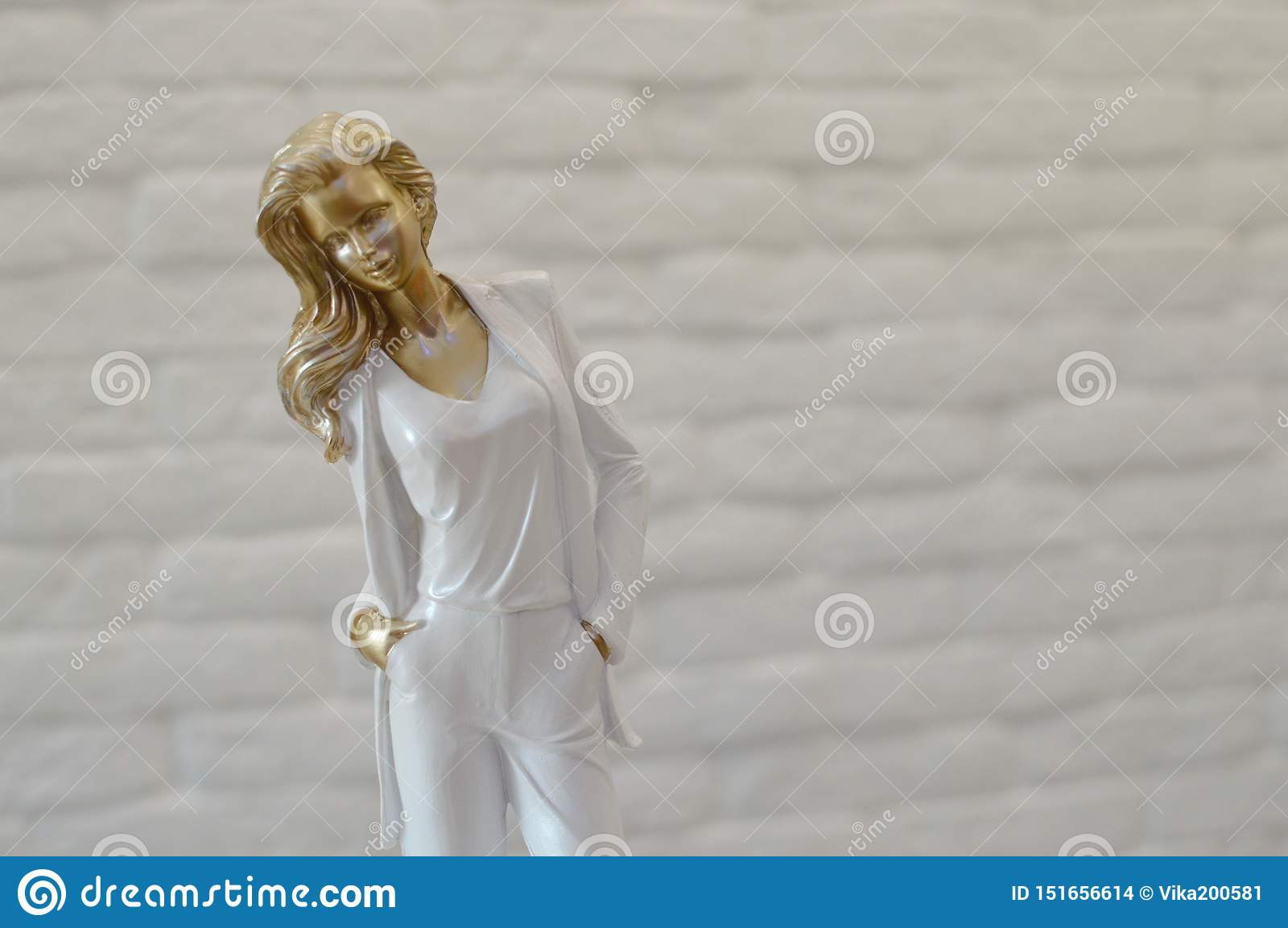 Stylish figurine of the young woman