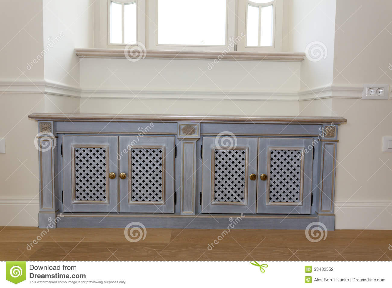 Stylish furniture chest under the window stock photography for Quel meuble sous une fenetre