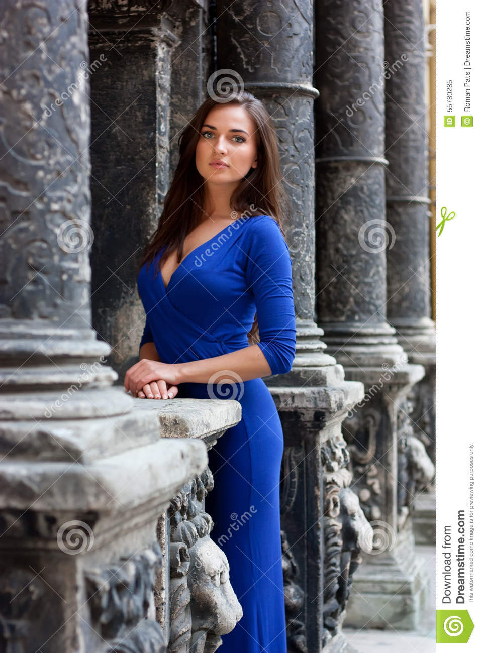 Stylish Girl In A Blue Dress Standing Next To Good Old Wall Stock ...