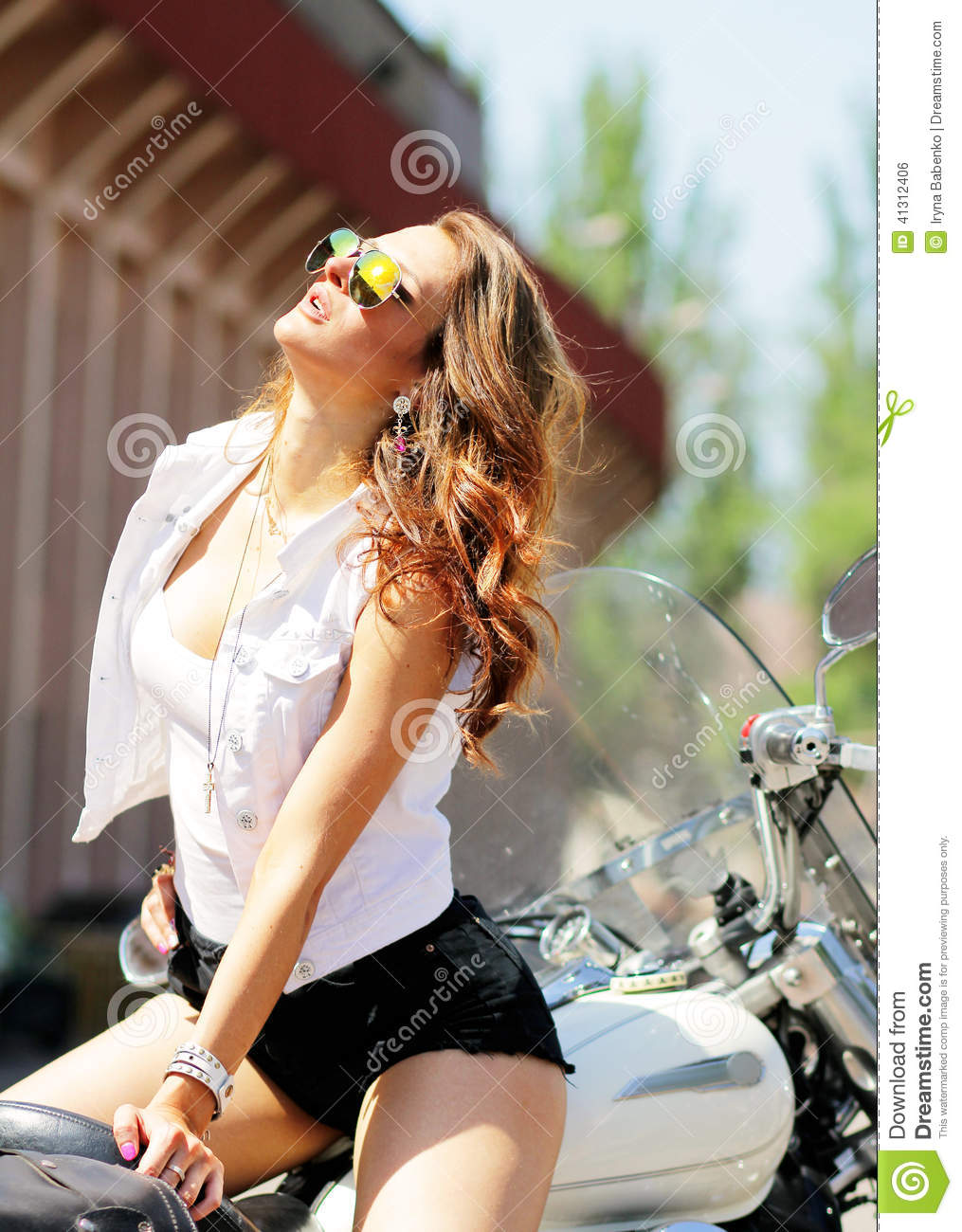 Stylish Girl On Colored Glasses On A Motorcycle Stock Photo
