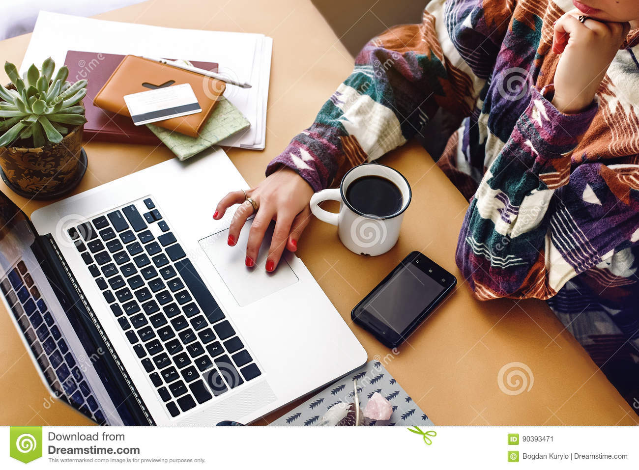 stylish girl hipster hands on laptop searching and typing, freelance and planning boho summer travel vacation concept