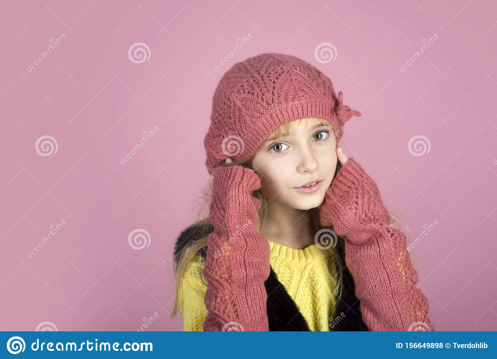 Stylish girl with pretty face. Little girl with long hair. Hairdresser, skincare, casual style, denim. Fashion model and
