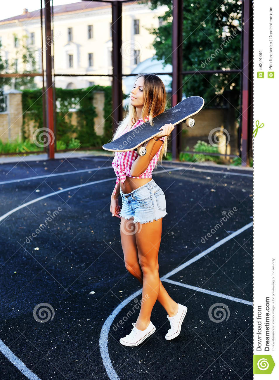 stylish girl with skateboard outdoor stock photo   image