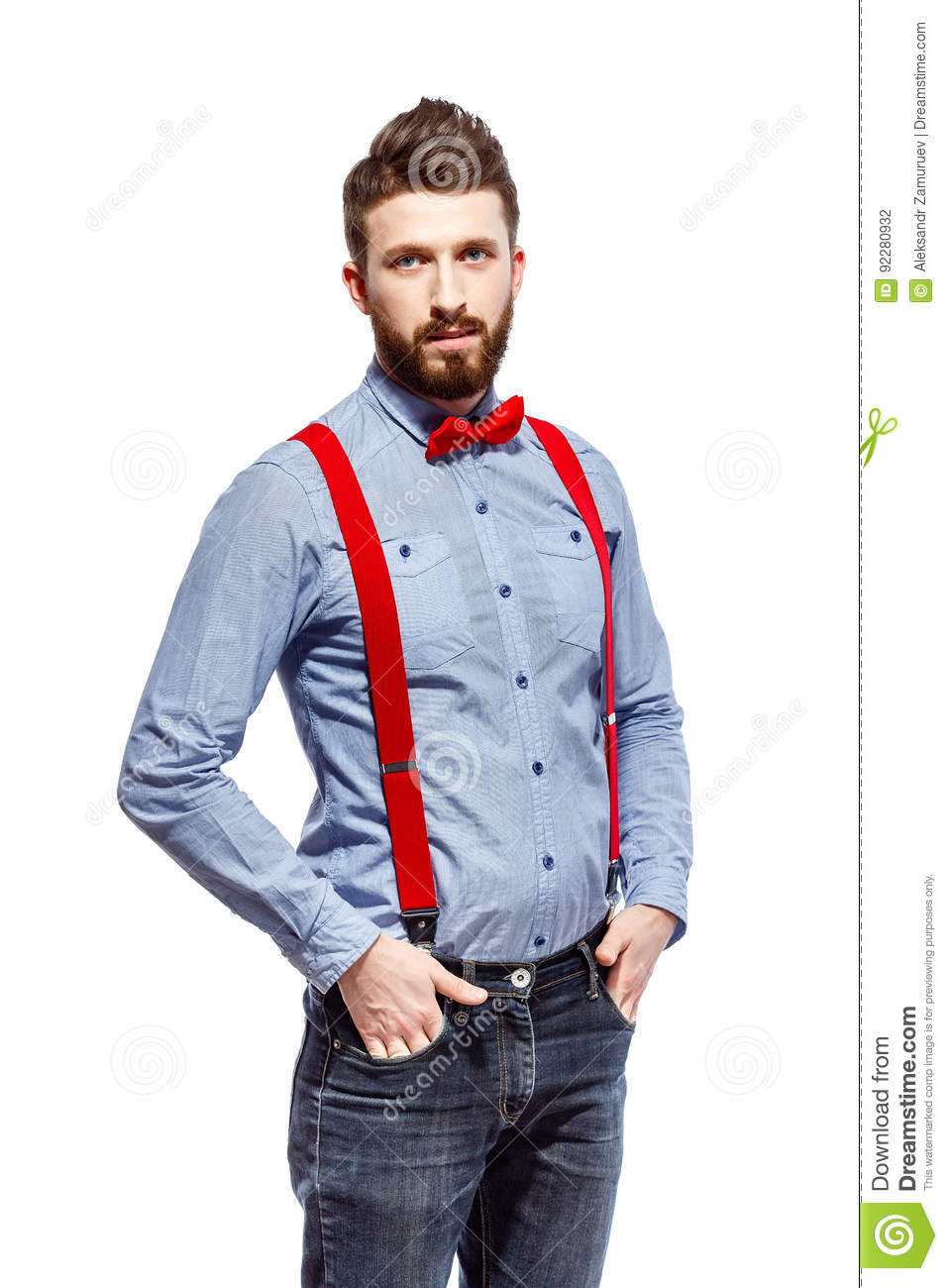 ce936f3818b9 Stylish guy wearing blue shirt, red bowtie and suspenders on white. smile.  stand. hands in the pocket.