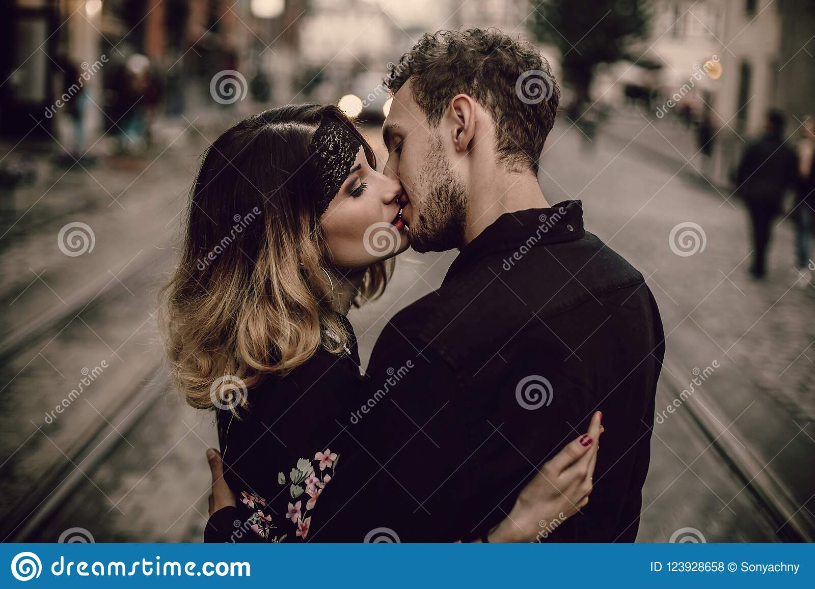 man and woman french kissing