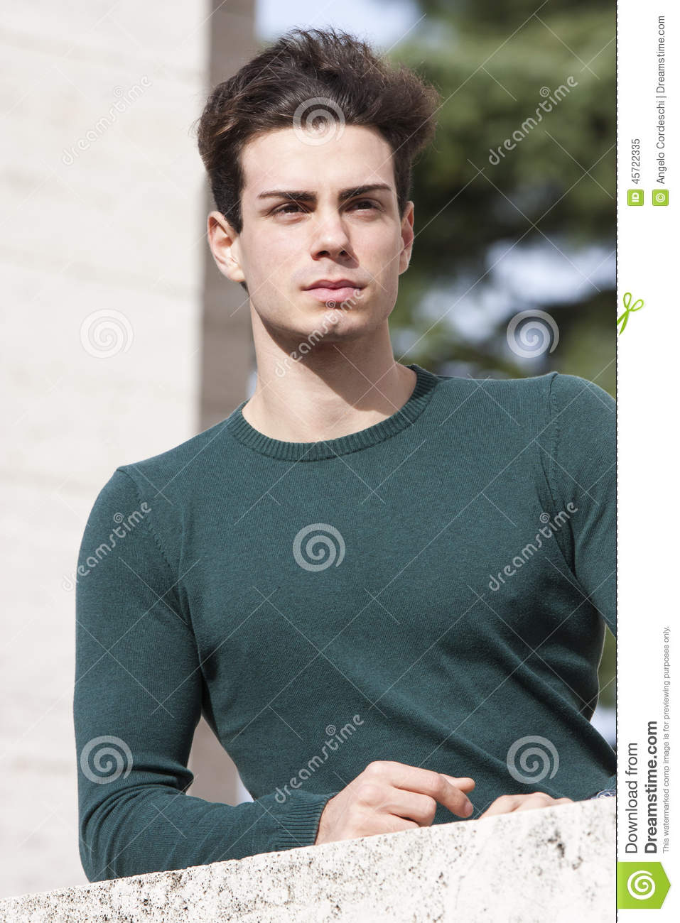 Stylish Hair Young Man Outdoors On The Ledge Tight Knit