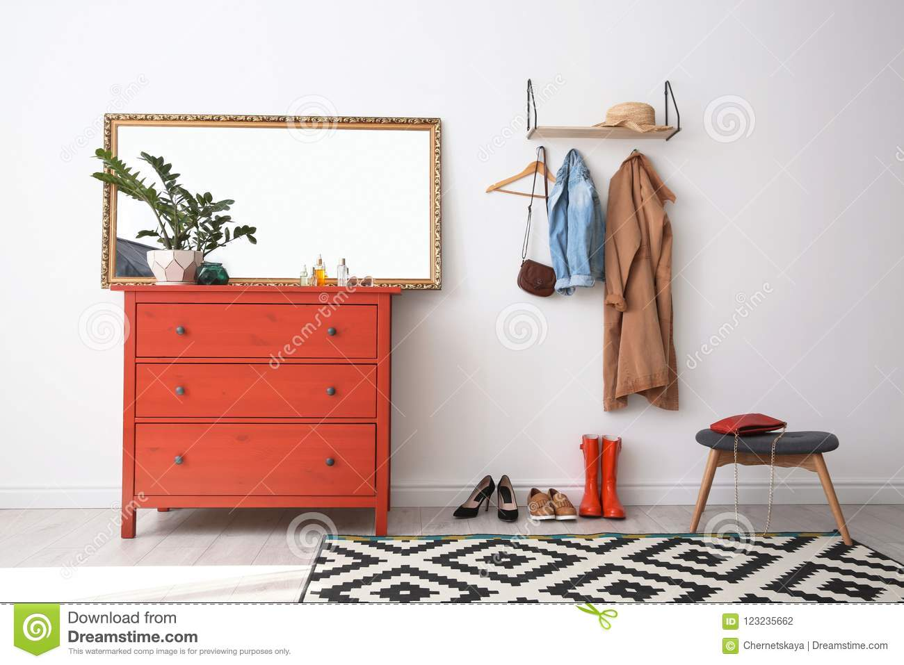 Chest of drawers in the hallway with a mirror