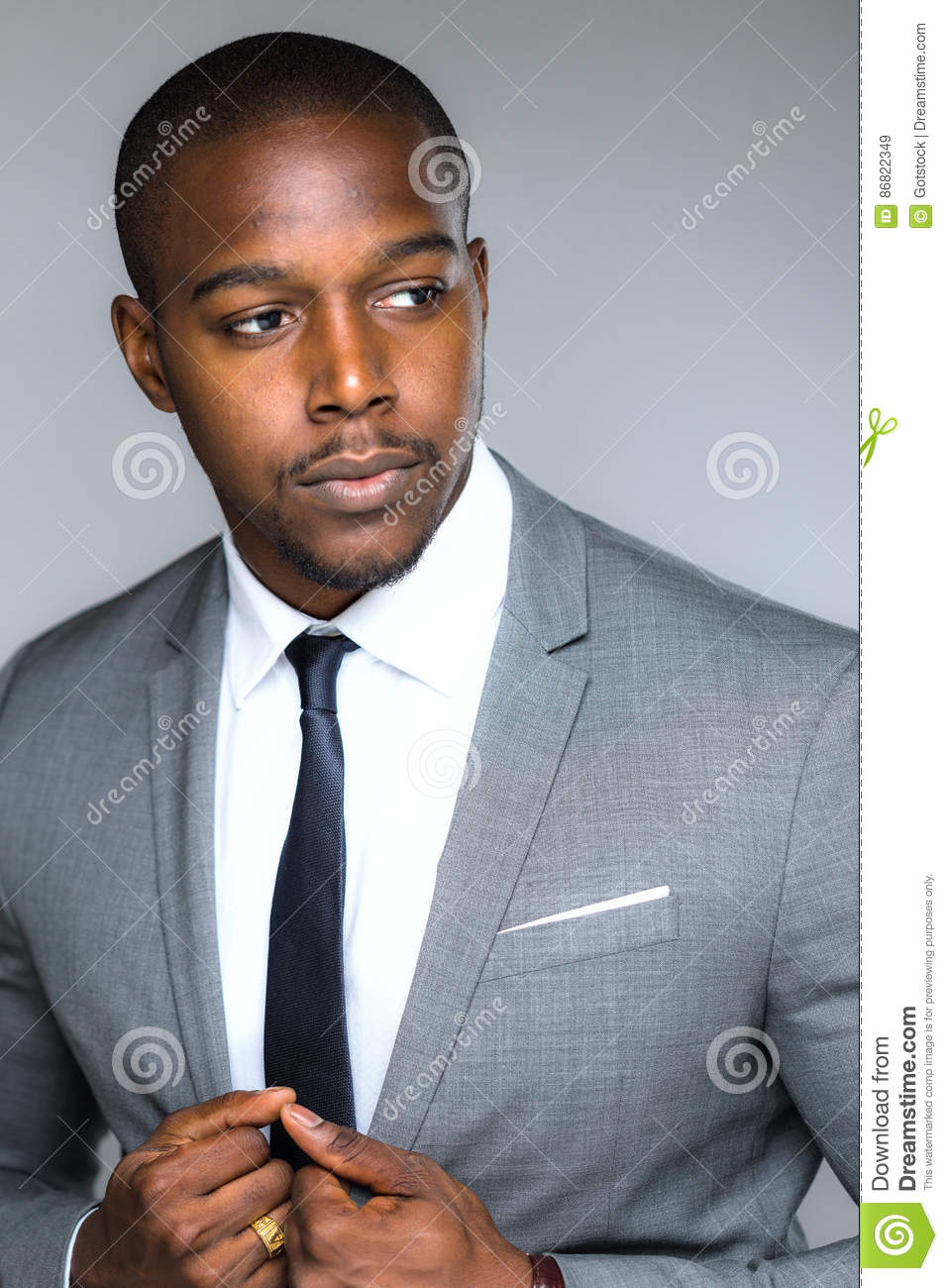 0cbbe031b9a Strong powerful handsome african american modern businessman pose looking  confident successful accomplished driven intense in full business suit