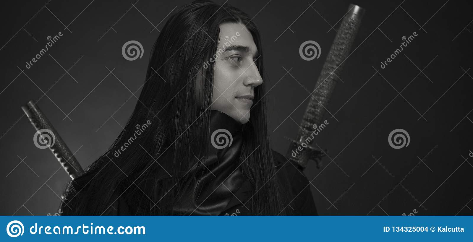 Stylish handsome Young man with Japanese katana sword. Caucasian man`s portrait