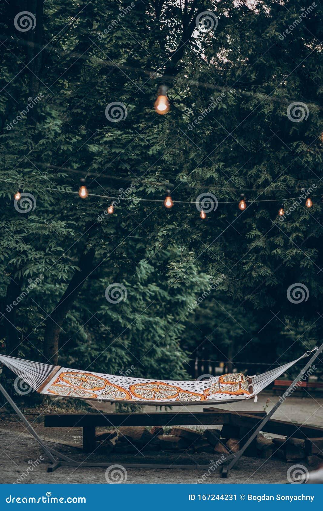 Stylish Hipster Hammock Under Romantic Lights In Park At ...