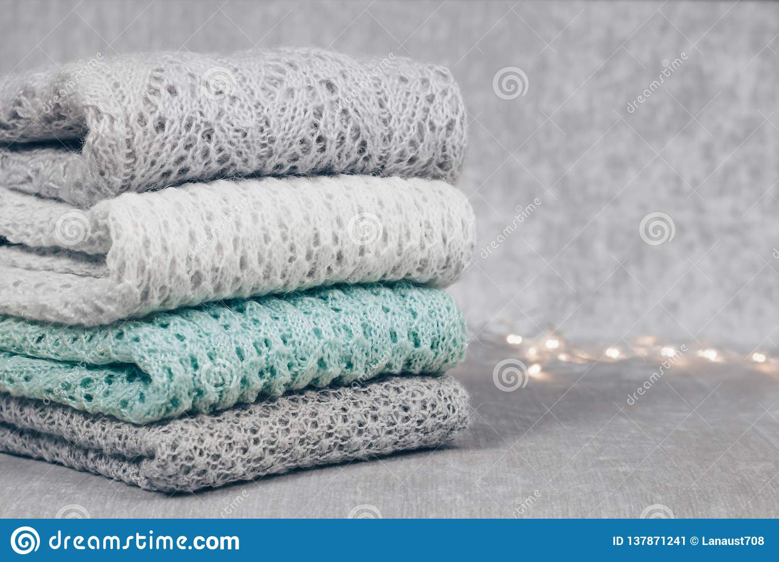 Stylish Knitted Pastel Colored Sweaters Folded In Stack On