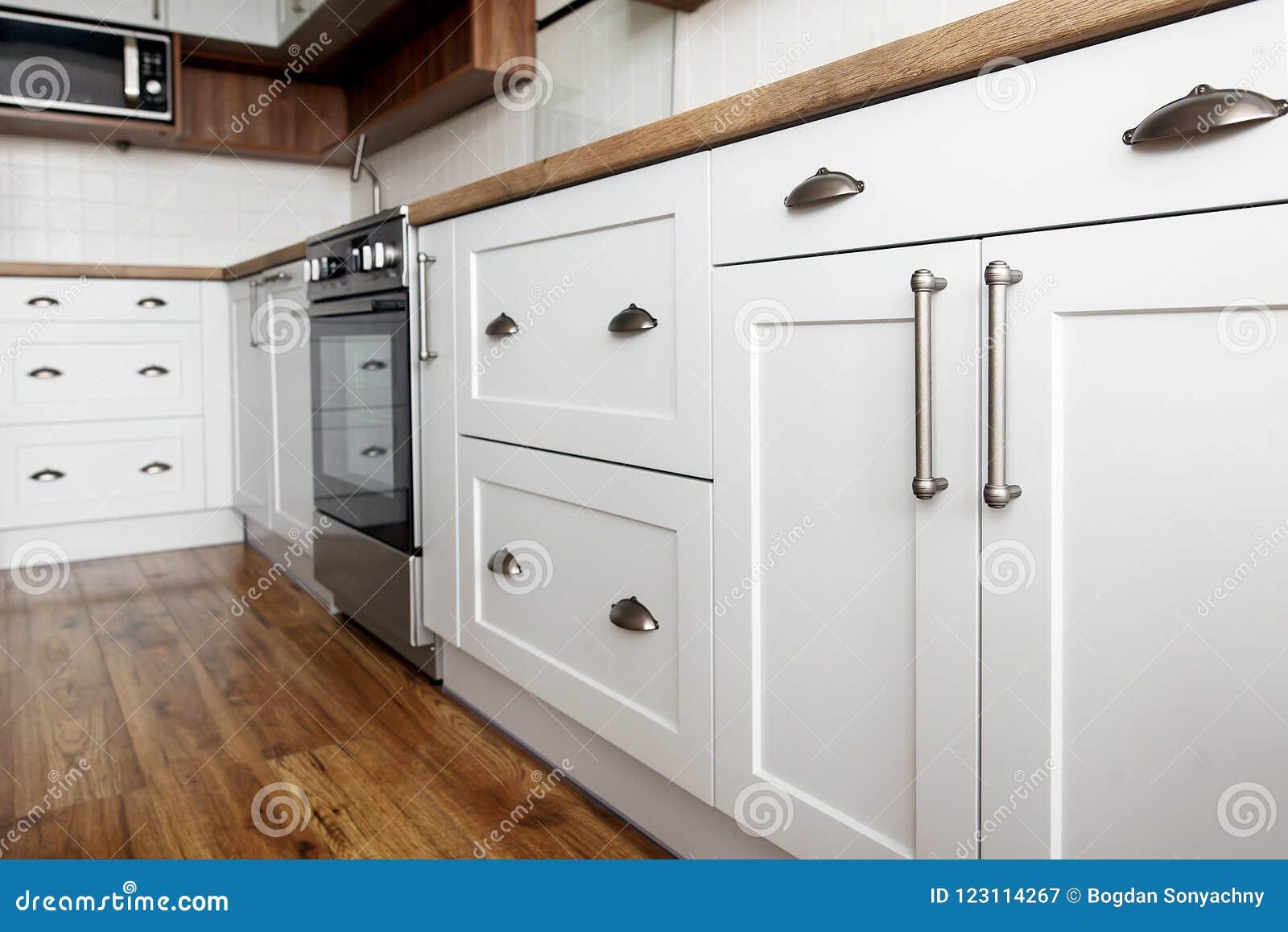 Stylish Light Gray Handles On Cabinets Close Up Kitchen Interior
