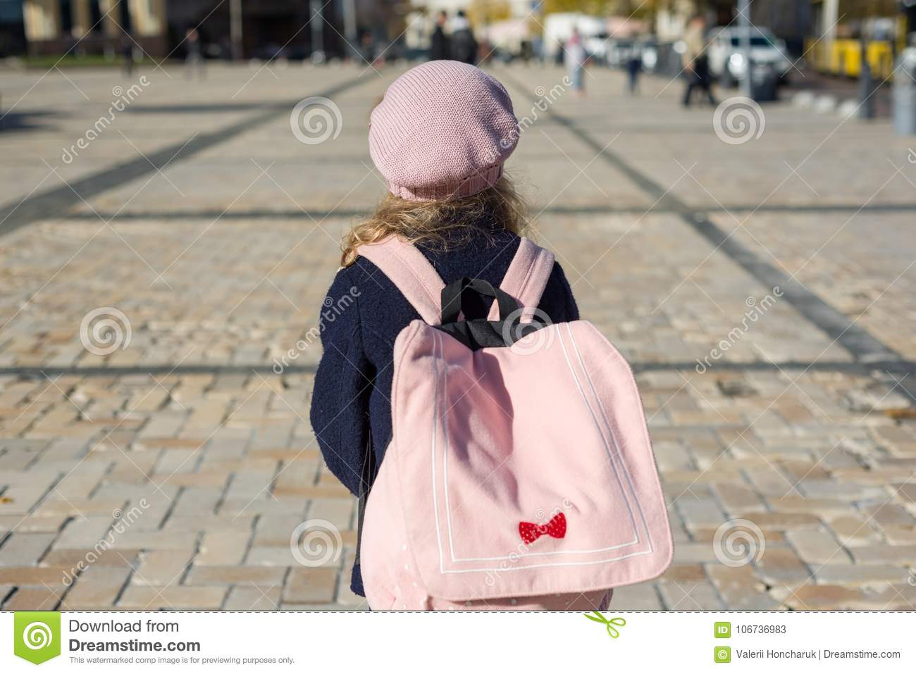 1d8347edae Stylish Little Girl With A Backpack