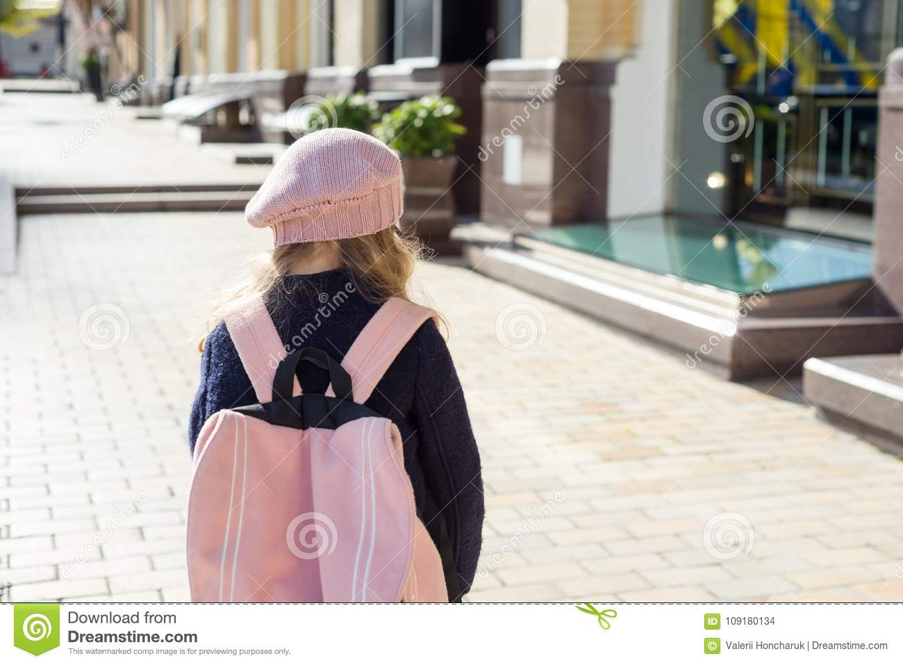277b688418 Stylish little girl with a backpack