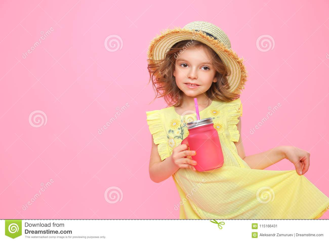 Stylish little girl with drink on pink