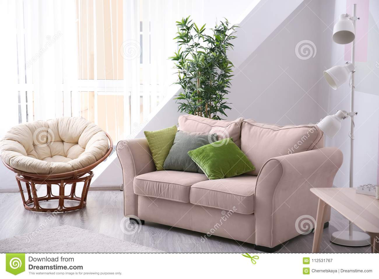 Stylish Living Room Interior With Comfortable Sofa Stock