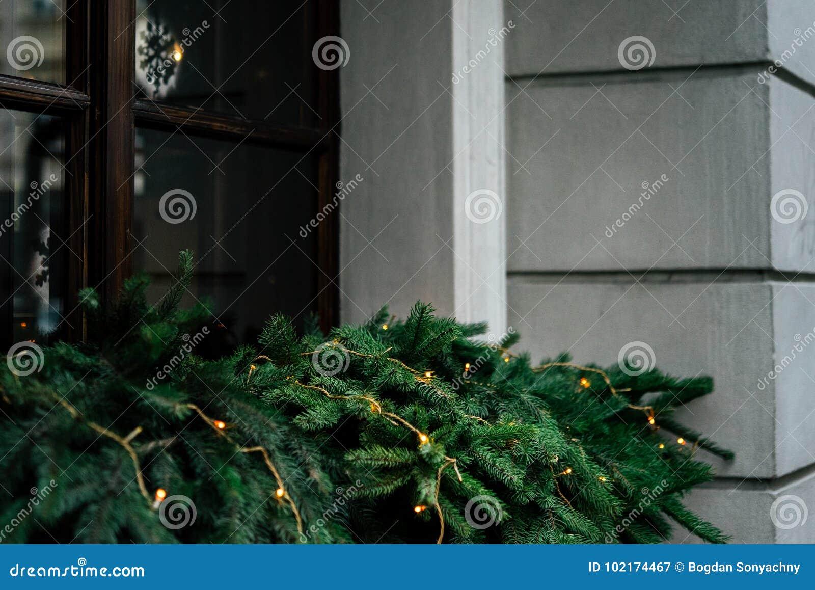 Stylish luxury christmas garland lights on window and green pin download stylish luxury christmas garland lights on window and green pin stock image image of aloadofball Image collections