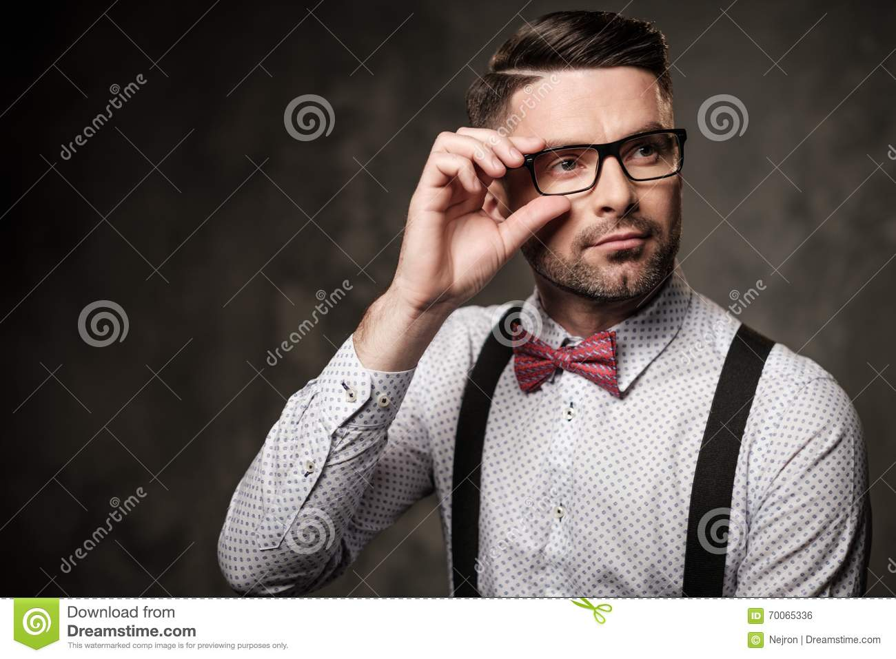Stylish Man With Bow Tie Wearing Suspenders And Posing On ...
