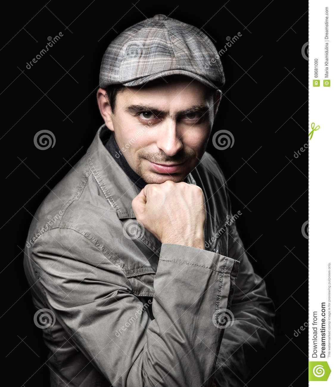 Stylish man in the pose of relying on his fist