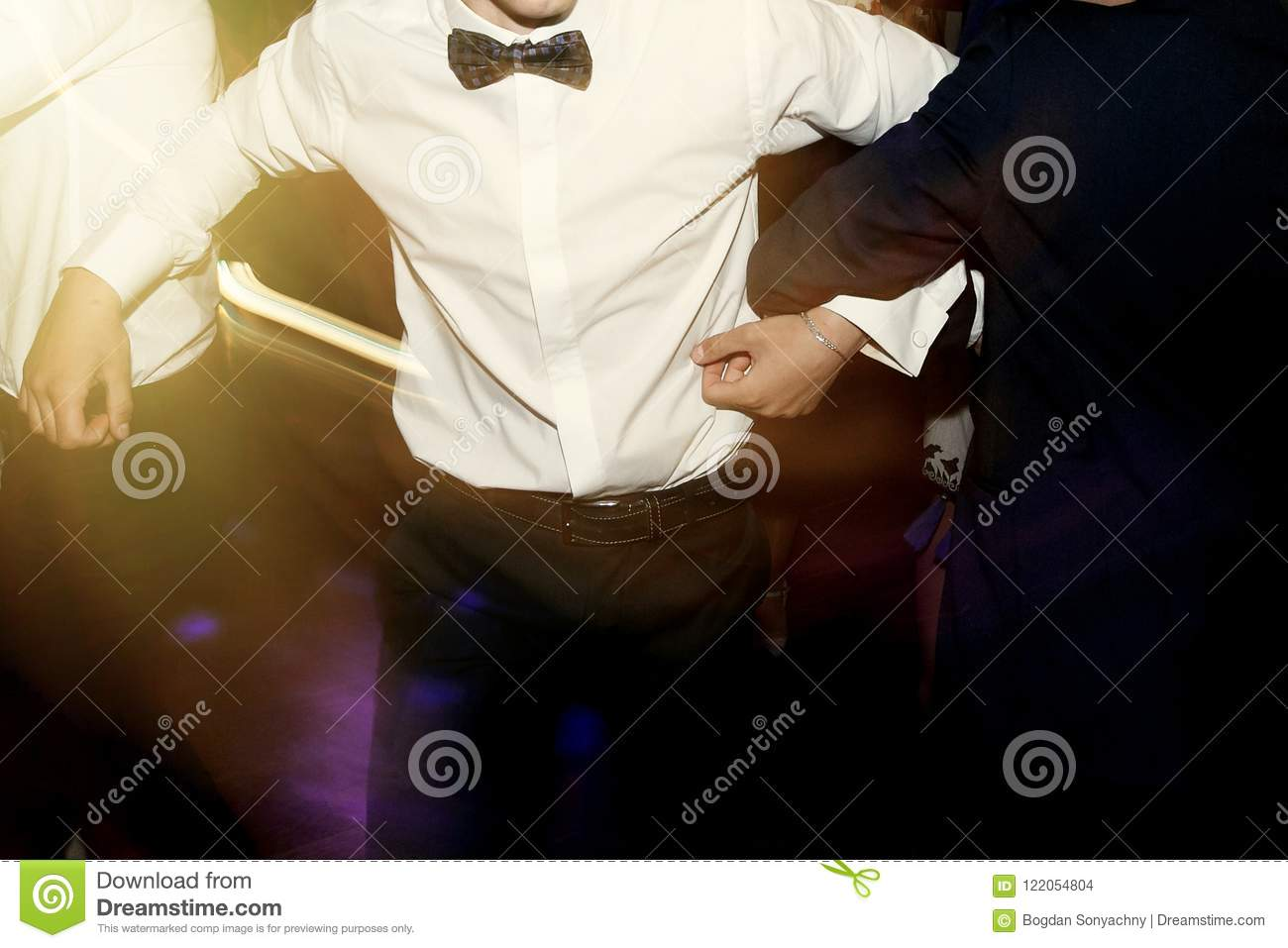 stylish men having fun and dancing at party in restaurant, reception at luxury wedding, rich graduation at school or university