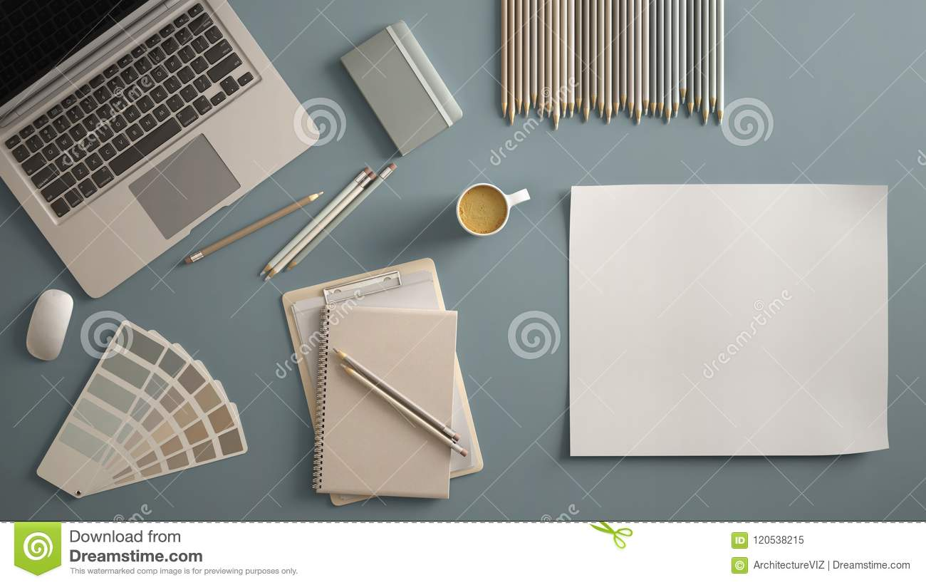 Stylish minimal office table desk. Workspace with laptop, notebook, pencils, coffee cup and sample color palette on pastel blue ba
