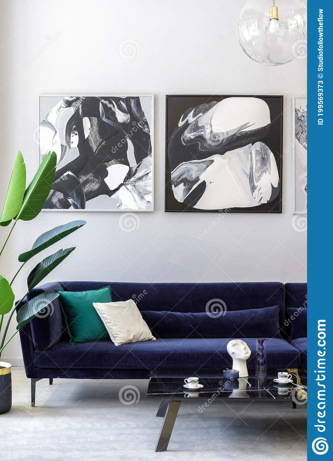 Stylish And Modern Living Room Interior With Blue Velvet Sofa Mock Up Paintings Design Furniture Plant Table Decoration Stock Image Image Of Furniture Concrete 199569373