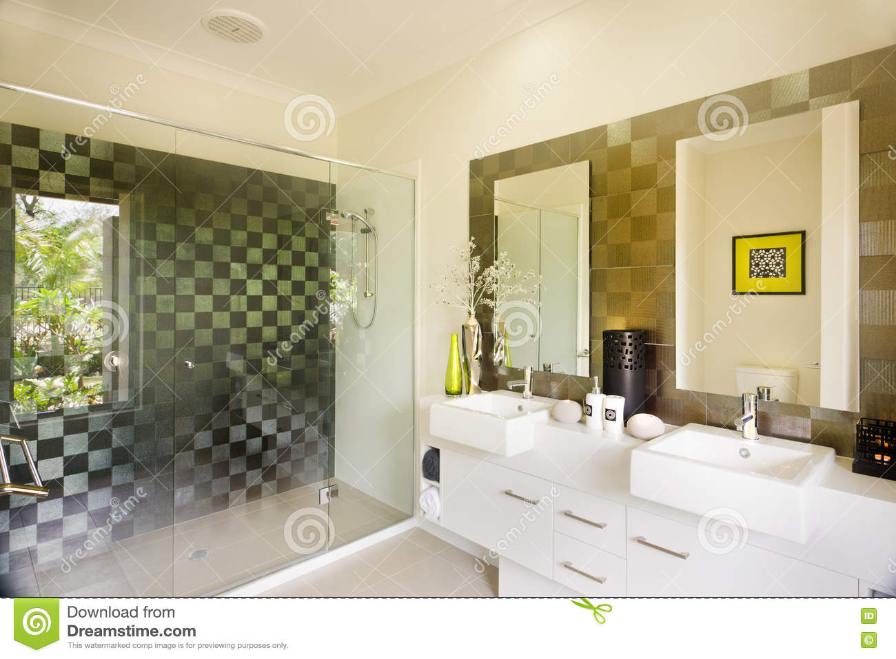 Stylish modern washroom with a glass shower and mirrors