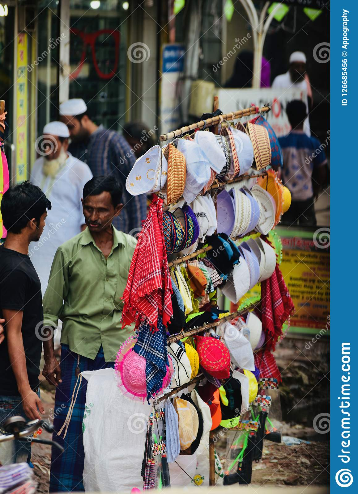 Stylish muslim topi in display around a street sales point unique photo