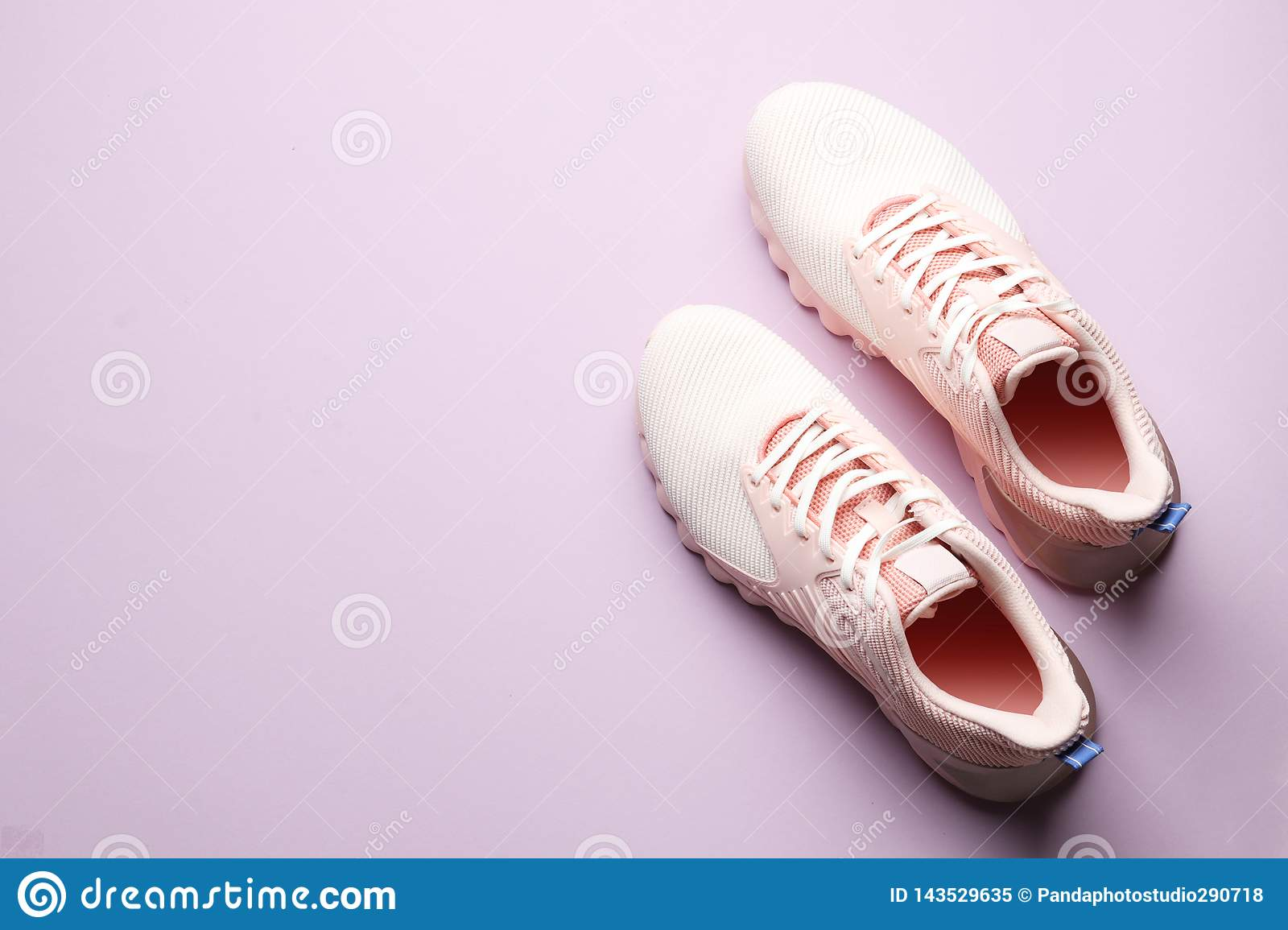 Stylish new shoes on color background