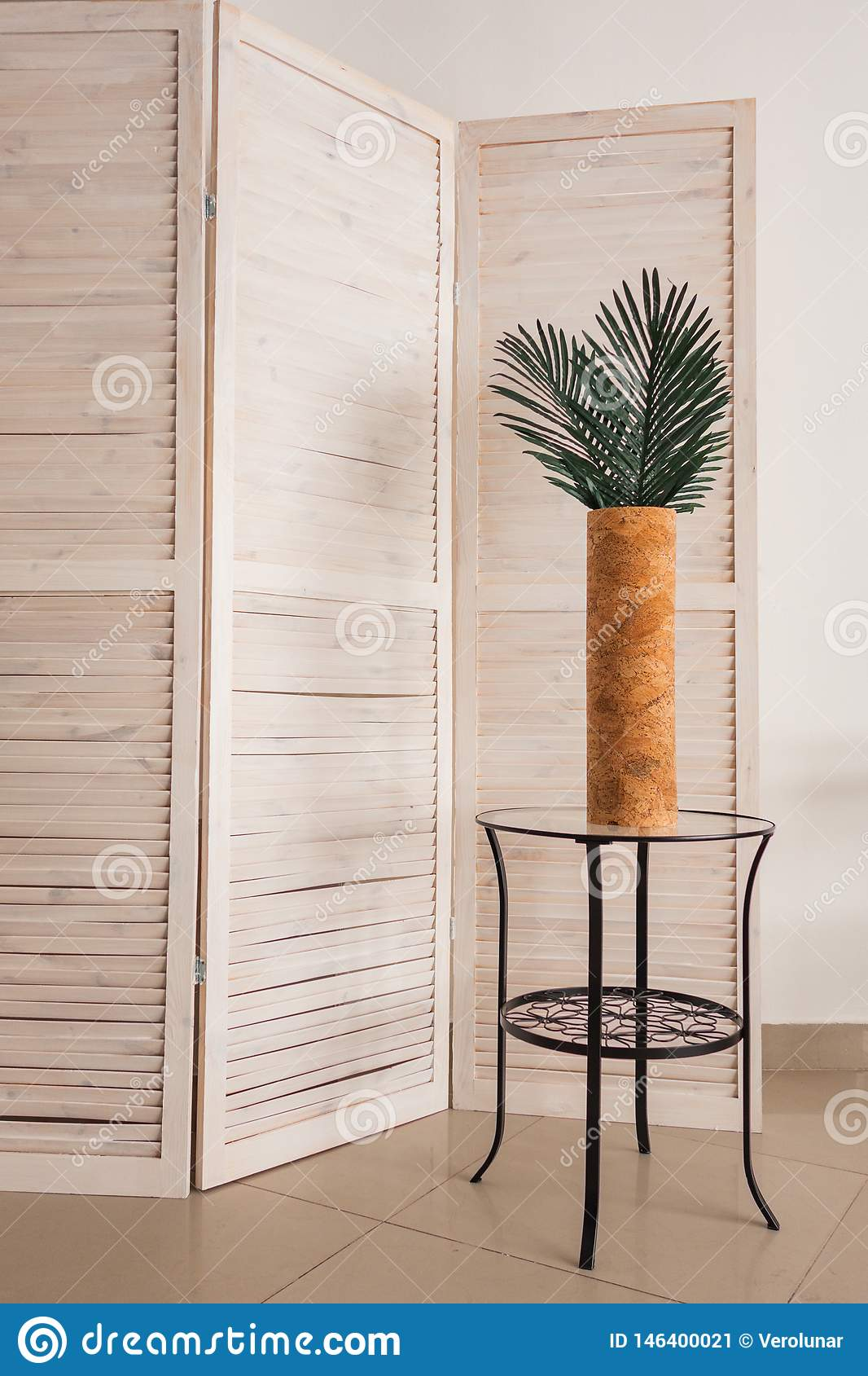 Stylish office decoration with tropical leaves