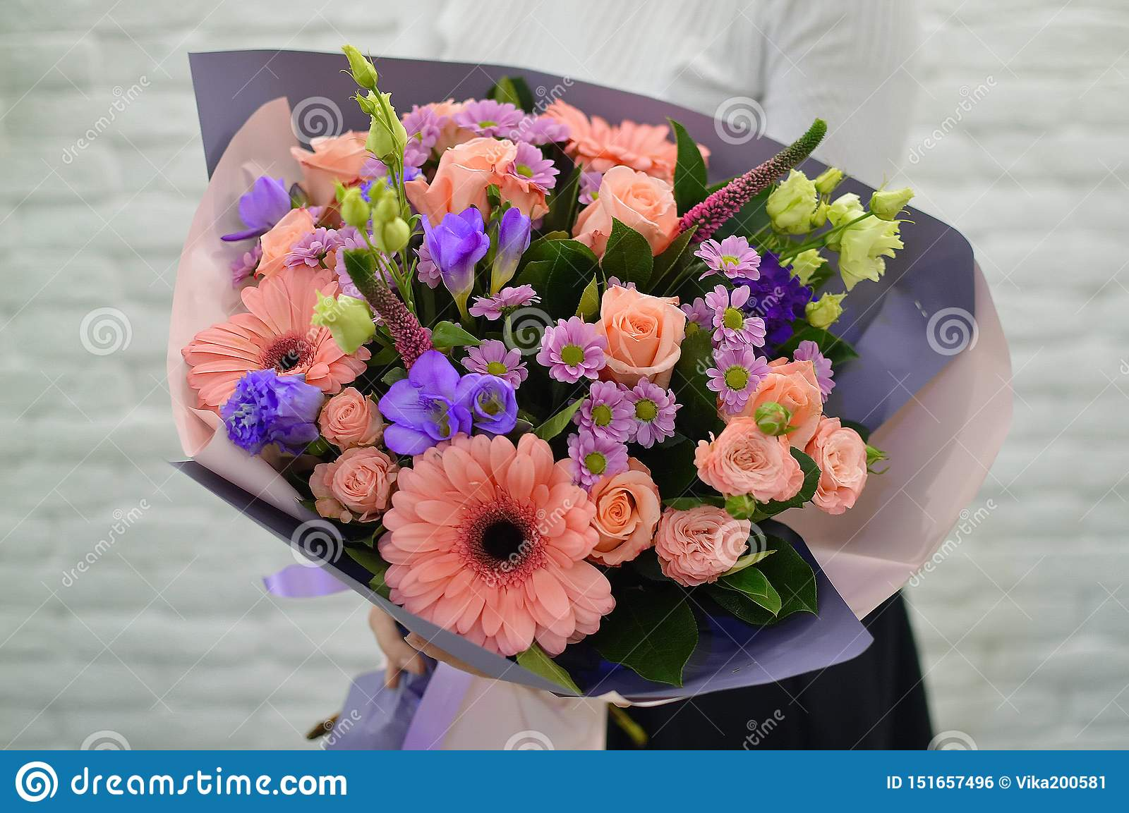 Stylish pink bouquet on a white background.