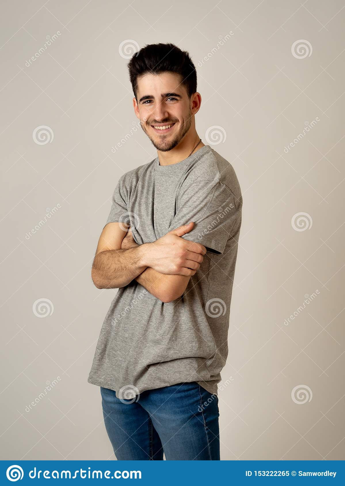 Stylish portrait of young cool man isolated on neutral background