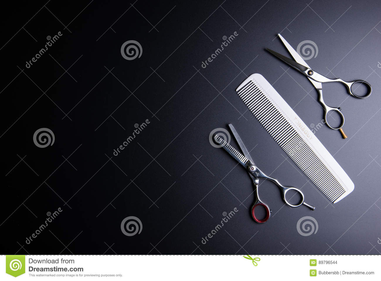 Stylish Professional Barber Scissors and white comb on black background. Hairdresser salon concept, Hairdressing Set. Haircut