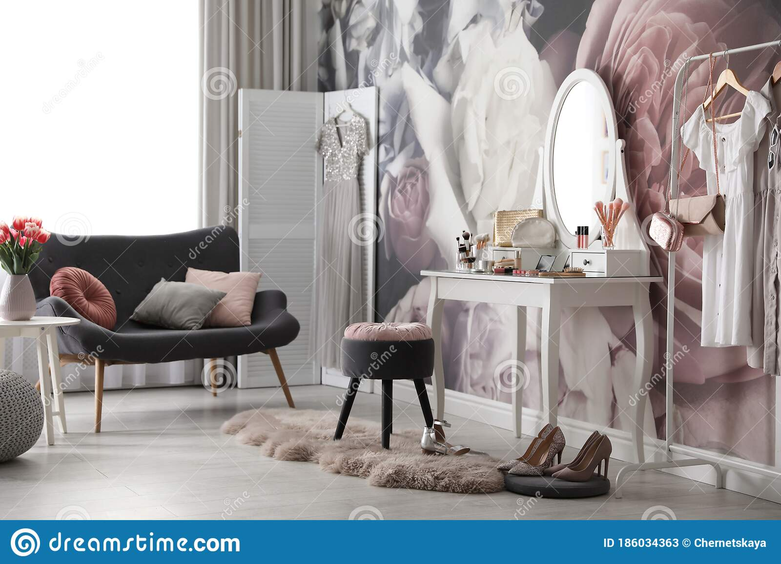 Room Interior With Elegant Dressing Table, Sofa And Floral
