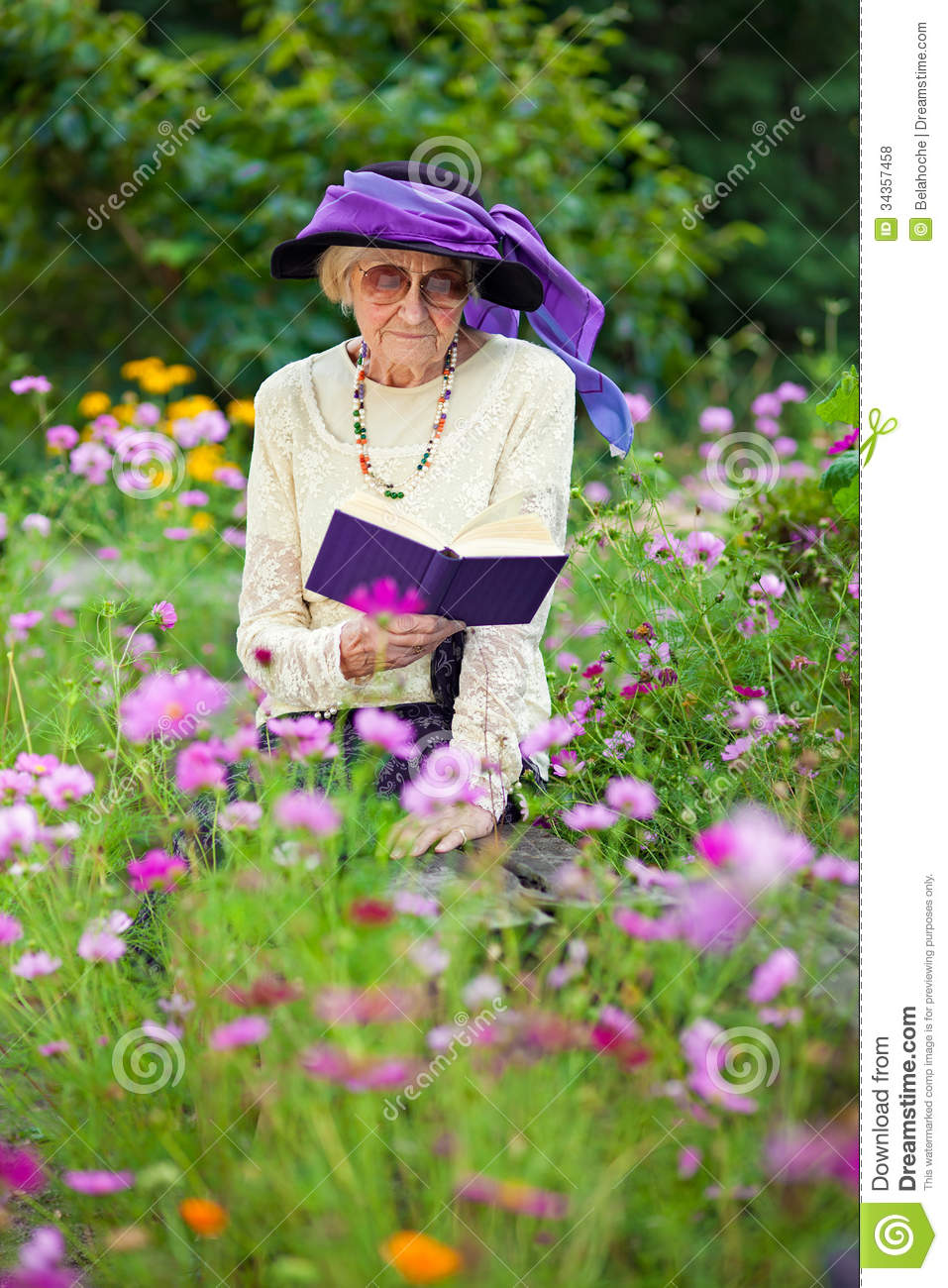Stylish Senior Woman Reading Outdoors Stock Photo Image