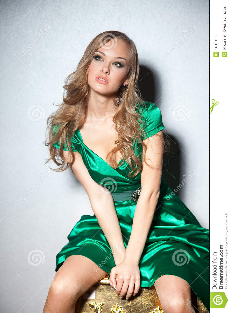 637db2161 Stylish Shot Of Girl In Green Dress Sitting Stock Image - Image of ...
